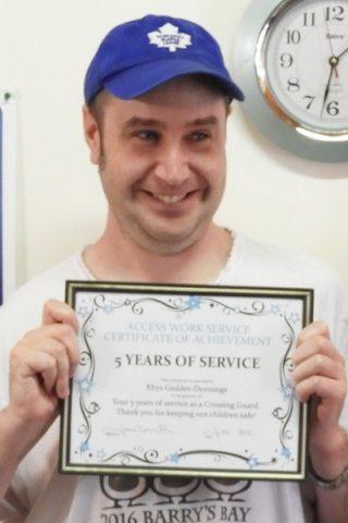 Crossing guard Rhys Geddes receives award